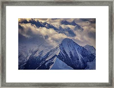 A Peak In The Clouds Framed Print by Rick Berk