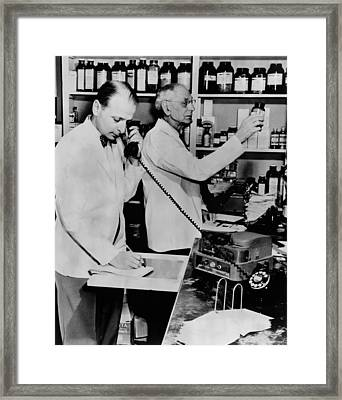 A Pharmacist Demonstrates The Use Of An Framed Print by Everett