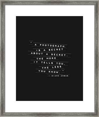 A Photograph Is A Secret Embossed Labels Framed Print