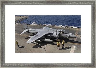 A Pilot Receives Signals From Air Framed Print by Stocktrek Images