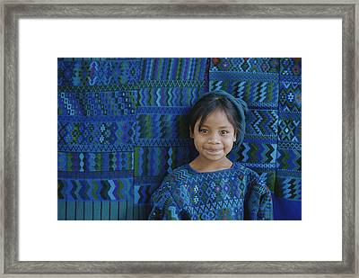 A Portrait Of A Guatemalan Girl Framed Print by Raul Touzon