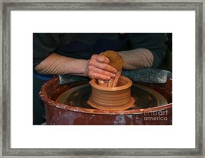 A Potter's Hands Framed Print by Marie Neder