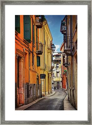 A Pretty Little Street In Verona Italy  Framed Print by Carol Japp