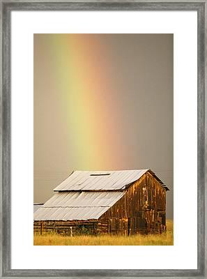 A Rainbow Arches From The Sky Onto Framed Print