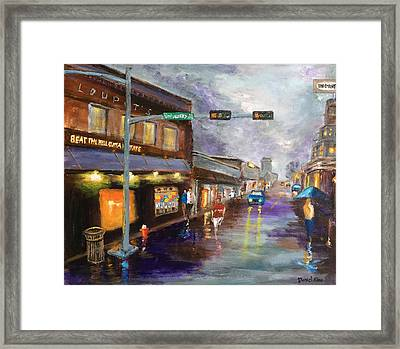 A Rainy Night At Northgate Framed Print by Daniel Xiao