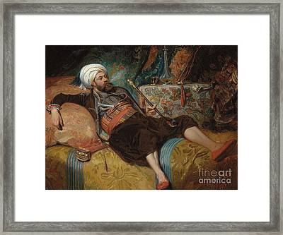 A Reclining Turk Smoking A Hookah, 1844 Framed Print by Henri Baron