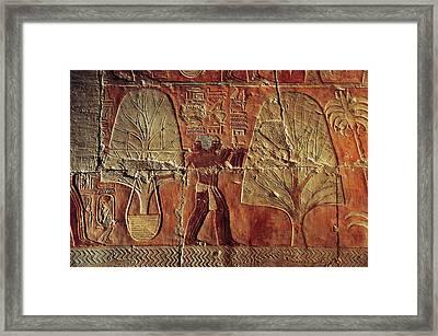 A Relief Of Men Carrying Myrrh Trees Framed Print by Kenneth Garrett