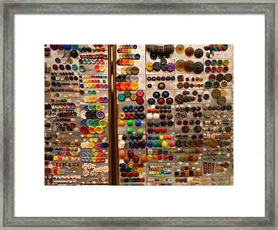 A Riot Of Buttons Framed Print