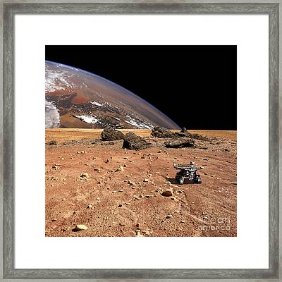A Robotic Rover Explores An Alien World Framed Print by Marc Ward