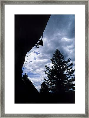 A Rock Climber Ascends A Steep Route Framed Print
