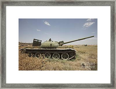 A Russian T-62 Main Battle Tank Rests Framed Print