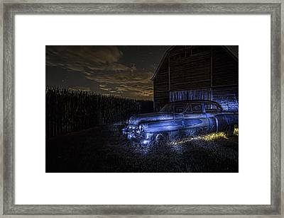 A Rusty 50's Cadillac In Painted Blue And Yellow Light One Starry Night Framed Print