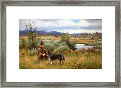 A Saami Boy Playing With His Dog Framed Print by Johan Tiren