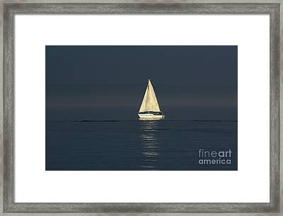 A Sailboat Capturing Light Framed Print