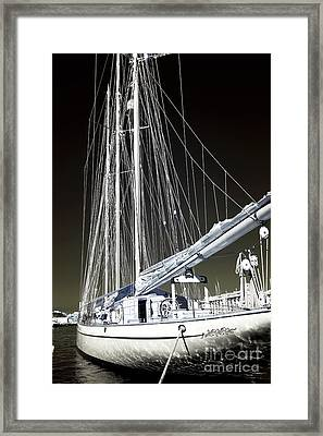 A Sailboat In Marseille Framed Print by John Rizzuto