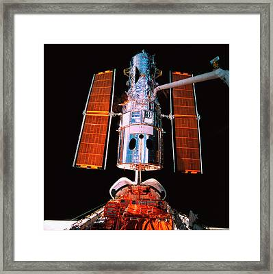 A Satellite Docked On The Space Shuttle Framed Print