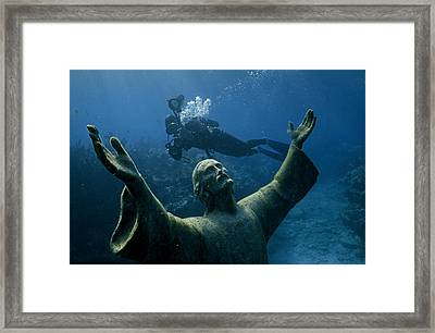 A Scuba Diver Swims Past The Statue Framed Print by Bates Littlehales