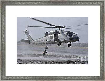 A Search And Rescue Swimmer Jumps Framed Print by Stocktrek Images