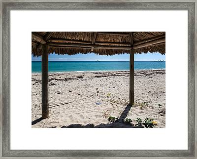 A Seat In A Tropical Beach Hut Framed Print by Michelle Wiarda