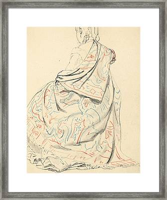 A Seated Woman's Dress From Behind Framed Print