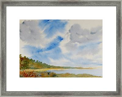 A Secluded Inlet Beneath Billowing Clouds Framed Print