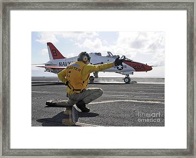 A Shooter Launches A T-45 Goshawk Framed Print by Stocktrek Images