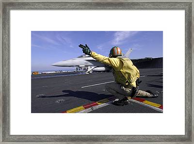 A Shooter Signals The Launch Of An Framed Print