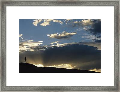 A Silhouetted Figure Trail Running Framed Print by Bobby Model