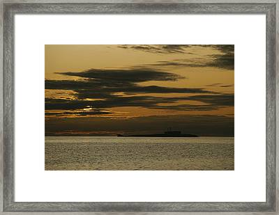 A Silhouetted Russian Submarine Framed Print by James P. Blair
