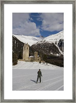 A Skier Along A Trail In The Engadin Framed Print by Taylor S. Kennedy