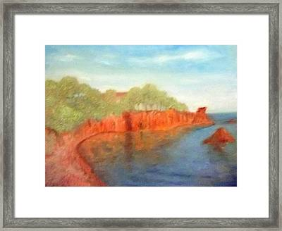 A Small Inlet Bay With Red Orange Rocks Framed Print