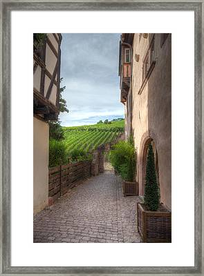 A  Small Side Street In Riquewihr Framed Print