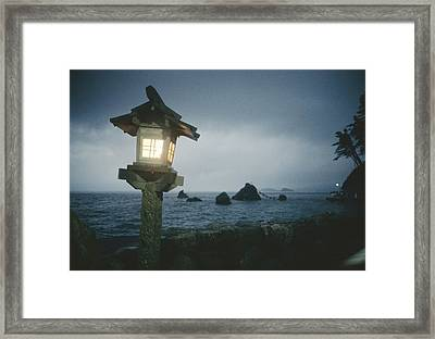 A Small Wooden Lantern Looks Framed Print by Luis Marden