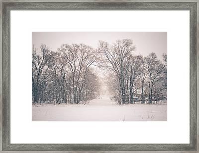 A Snowy Monday Framed Print
