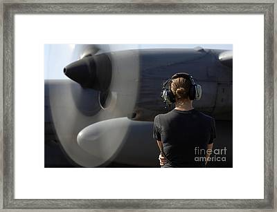 A Soldier Monitors The Performance Framed Print by Stocktrek Images