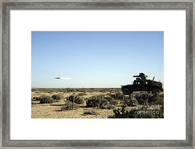 A Soldier Tests His Skill With The Tube Framed Print