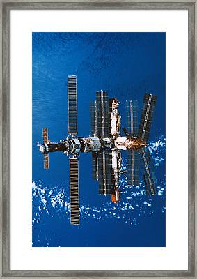 A Space Station Orbiting In Space Framed Print