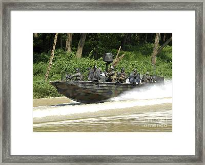 A Special Operations Craft Riverine Framed Print by Stocktrek Images