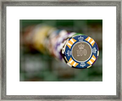A Stack Of Gambling Chips Stacked High Framed Print by Justin Guariglia