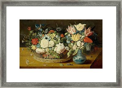 A Still Life With Flowers In A Woven Basket And A Floral Bouquet Framed Print
