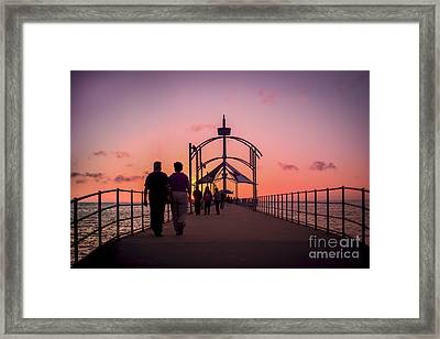 A Stroll Along Sunset Pier Framed Print