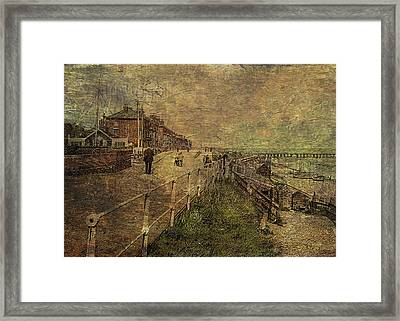 A Stroll Along The Seafront Framed Print by Sarah Vernon