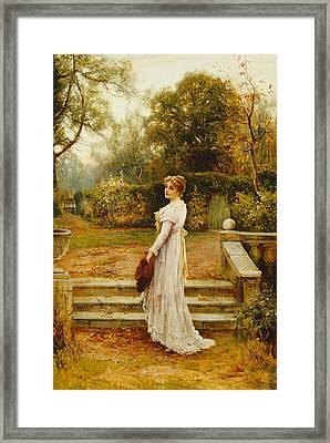 A Stroll In The Garden Framed Print by Ernest Walbourn