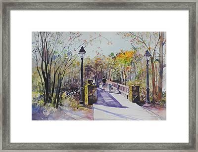 A Stroll On The Bridge Framed Print