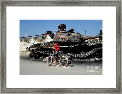 A Syrian Boy On His Bicycle In Front Framed Print by Andrew Chittock