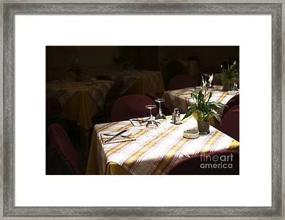 A Table Is Waiting In Sorrento Framed Print by John Rizzuto