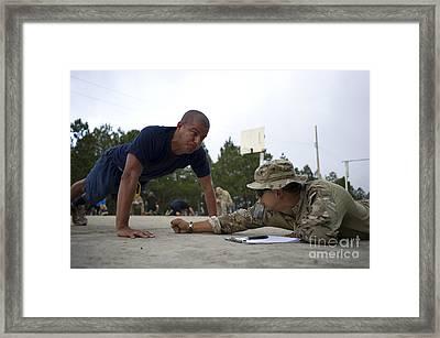 A Tigres Commando Conducts Push-ups Framed Print
