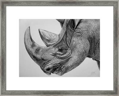 Rhinoceros - A Peaceful Giant Framed Print by Vishvesh Tadsare