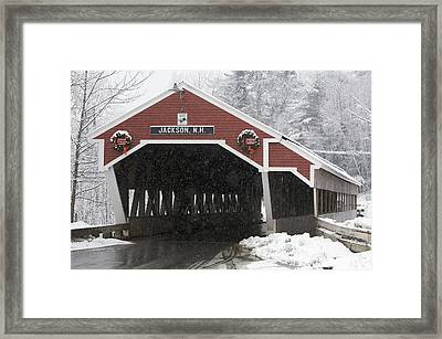 A Traditional Covered Bridge On A Snowy Framed Print by Tim Laman