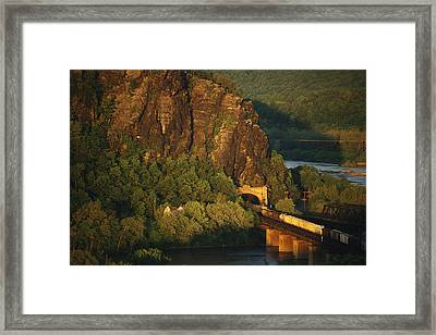 A Train Enters A Tunnel From A Railroad Framed Print